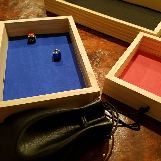 trying out the finished dice trays with kids' new polyhedral dice