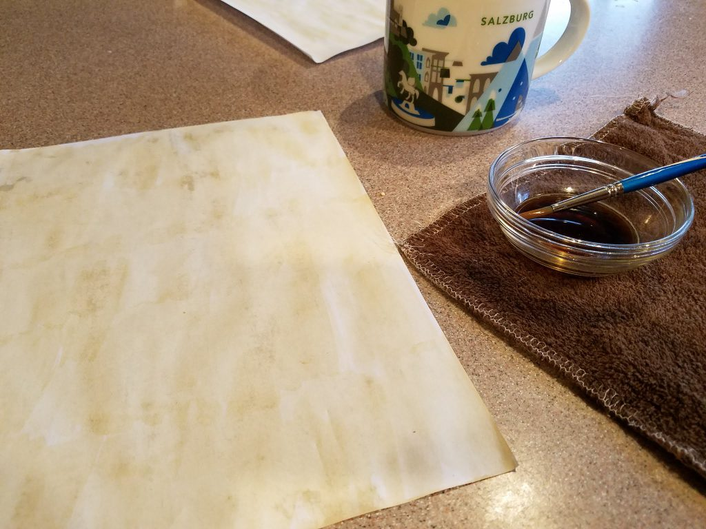 sacrificing some of my coffee to tint the paper for the letter prop